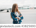 Young stewardess in uniform on aircraft parking 43825693