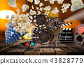 Pop-corn, movie tickets, clapperboard and other things in motion. 43828779