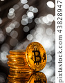 Bitcoin gold coins with defocused abstract background. Virtual cryptocurrency concept. 43828947