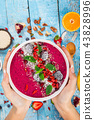 Smoothie bowl with fresh berries, nuts, seeds, fruit and vegetables. 43828996
