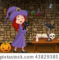 Cartoon little witch hugging black cat in the room 43829385