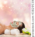 Young healthy woman with face clay mask. 43829539