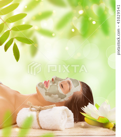 Young healthy woman with face clay mask. 43829541