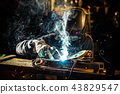 Welder working at the factory made metal 43829547