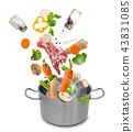 Stainless steel pot with flying ingredients. 43831085