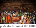 Fresh tasty seafood served on old wooden table. 43831089