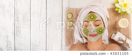 Young healthy woman with face clay mask. 43831105