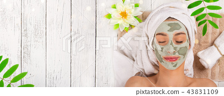 Young healthy woman with face clay mask. 43831109