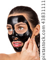 Portrait of young healthy woman with black peel face mask. 43831111