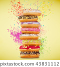 Tasty doughnuts on pastel blue background. 43831112