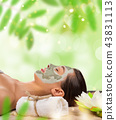 Young healthy woman with face clay mask. 43831113