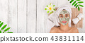 Young healthy woman with face clay mask. 43831114