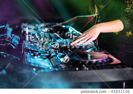 Dj mixes the track in the nightclub at a party 43831136