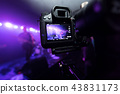 Man capturing the moment on rock concert. 43831173