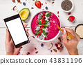 Smoothie bowl with fresh berries, nuts, seeds, fruit and vegetables. 43831196