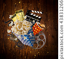 Pop-corn, movie tickets, clapperboard and other things in motion. 43831266