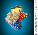 Pop-corn, movie tickets, clapperboard and other things in motion. 43831277