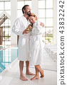 Pleasant nice man hugging his beautiful wife 43832242