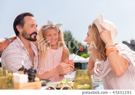 Delighted positive bearded man holding a fork 43832291