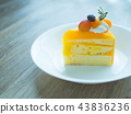 Orange cake with topping mix fruit on white plate 43836236