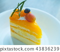 Orange cake with topping mix fruit on white plate 43836239