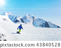 Winter snowboarding activity on sunny day in Alps 43840528