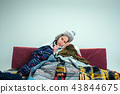 The young woman with Flue Sitting on Sofa at Home. Healthcare Concepts. 43844675
