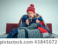Bearded Man with Flue Sitting on Sofa at Home. Healthcare Concepts. 43845072