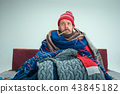 Bearded Man with Flue Sitting on Sofa at Home. Healthcare Concepts. 43845182