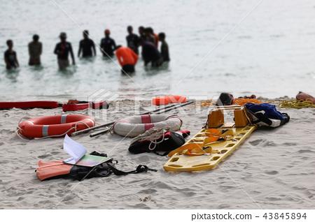 Medical emergency bag or first aid kit on beach 43845894