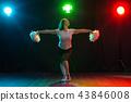 Full length portrait of cheerleader dancing with pom-poms 43846008