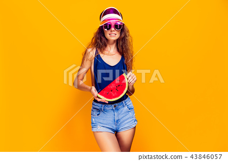 Woman in cap and swimwear hold slice of watermelon 43846057
