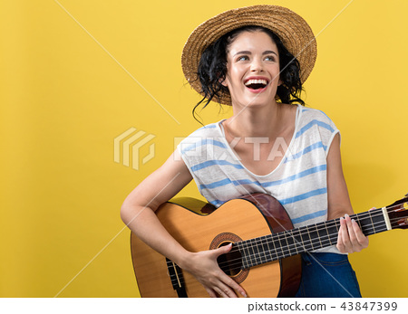 Young woman with a guitar 43847399