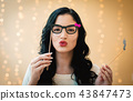 Young woman with paper glasses and mustache sticks 43847473