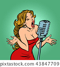 woman singer at the microphone. Music concert scene 43847709