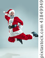 Funny guy in christmas hat. New Year Holiday. Christmas, x-mas, winter, gifts concept. 43849949