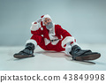 Funny guy in christmas hat. New Year Holiday. Christmas, x-mas, winter, gifts concept. 43849998