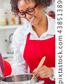 Mixed Race African American Woman Cooking Kitchen 43851389