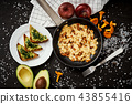 scrambled eggs with chanterelles straight from the forest in a pan and bread with avocado 43855416