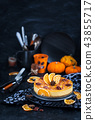 Delicious pumpkin and orange cheesecake  43855717