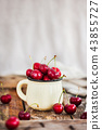 Fresh ripe cherries in a mug on rustic background 43855727
