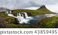 Kirkjufellfoss and Kirkjufell mountain in Iceland. 43859495