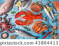 Fresh tasty seafood served on old wooden table. 43864413