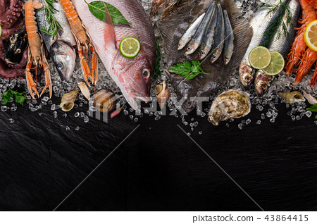 Fresh tasty seafood served on old wooden table. 43864415
