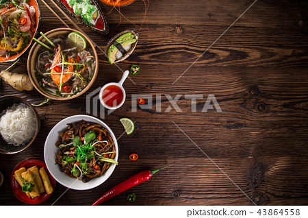 Various of asian meals on rustic background , top view , place for text. 43864558