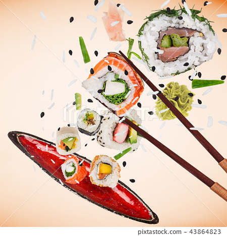 Pieces of delicious japanese sushi frozen in the air. 43864823