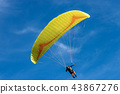 Paragliding on a Blue sky with Clouds 43867276