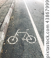 Bicycle path symbol on the road. 43867999