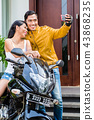 Couple taking self portrait with motorcycle 43868235