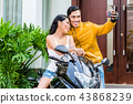 Couple taking selfie with motorcycle 43868239